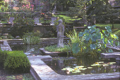 view [Gracie's Garden]: pond with aquatic plants and female statue in center looking towards terraces. digital asset: [Gracie's Garden]: pond with aquatic plants and female statue in center looking towards terraces.: 2004 Jun.