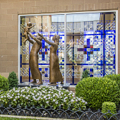 view [St. Thomas More Rosary Garden]: the bronze sculpture and stained glass window at the north end of the Rosary Garden. digital asset: [St. Thomas More Rosary Garden]: the bronze sculpture and stained glass window at the north end of the Rosary Garden.: 2016 Jul.