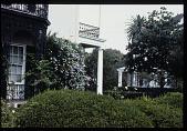 view [Strachan Garden]: tea house seen through shrubs. digital asset: [Strachan Garden]: tea house seen through shrubs.: 1987 October 1