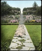 view [The Chimneys]: walkway leads up to stairs lined by a variety of shrubs, flowers, and trees. digital asset: [The Chimneys]: walkway leads up to stairs lined by a variety of shrubs, flowers, and trees.: [between 1914 and 1949?]
