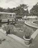 view [The Chimneys]: ponds, with lillies, surrounded by walkways and potted plants. Fence and pergola in background. digital asset: [The Chimneys]: ponds, with lillies, surrounded by walkways and potted plants. Fence and pergola in background.: circa 1920s.