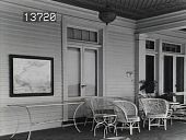 view [The Chimneys]: porch with outdoor furniture and a framed map on the wall. digital asset: [The Chimneys]: porch with outdoor furniture and a framed map on the wall.: [1930?]