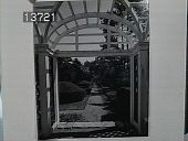 view [The Chimneys]: view of walkway and topiary from beneath pergola. digital asset: [The Chimneys]: view of walkway and topiary from beneath pergola.: [1930?]