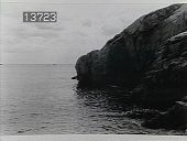 view [The Chimneys]: view of bay and large rocks. digital asset: [The Chimneys]: view of bay and large rocks.: [1930?]