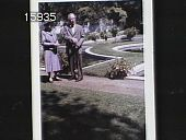 view [The Chimneys]: man and woman standing in the garden with the circular lilly pond. digital asset: [The Chimneys]: man and woman standing in the garden with the circular lilly pond.: 08/30/1958