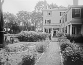 view [Miscellaneous Sites in Salem, Massachusetts]: the garden at 10 Chestnut Street. with Hamilton Hall in the distance. digital asset: [Miscellaneous Sites in Salem, Massachusetts] [glass negative]: the garden at 10 Chestnut Street, with Hamilton Hall in the distance.