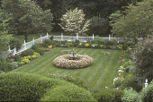 view [Apple Trees]: overview of formal square sunken garden with central fountain, picket fence, and benches. digital asset: [Apple Trees]: overview of formal square sunken garden with central fountain, picket fence, and benches.: 2005 Jul.