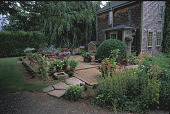 view [Haskell Garden]: brick patio and residence with birdbath and stone walkway. digital asset: [Haskell Garden]: brick patio and residence with birdbath and stone walkway.: 2001 Jul.