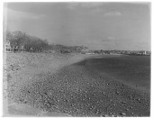 view [Miscellaneous Sites in Gloucester, Massachusetts]: looking along the beach with the Surfside (formerly Pavilion) Hotel in the distance. digital asset: [Miscellaneous Sites in Gloucester, Massachusetts] [glass negative]: looking along the beach with the Surfside (formerly Pavilion) Hotel in the distance.