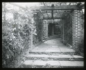 view Edgewood (MD): a pergola and stone walk. digital asset: Edgewood (MD) [lantern slide]: a pergola and stone walk.