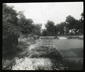 view [Edgewood (MD)]: borders in the sunken garden, with the shadow of the pergola visible on the right. digital asset: [Edgewood (MD)] [lantern slide]: borders in the sunken garden, with the shadow of the pergola visible on the right.