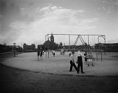 view [Latrobe Park]: boys in playground area, with Our Lady of Good Counsel church in the background. digital asset: [Latrobe Park] [glass negative]: boys in playground area, with Our Lady of Good Counsel church in the background.