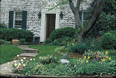 view [Voorhees Garden]: entrance garden in spring. digital asset: [Voorhees Garden]: entrance garden in spring.: 2000 May.