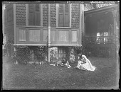 view [Tanglewood]: Florence with dog by Liebig house. digital asset: [Tanglewood] [glass negative]: Florence with dog by Liebig house.