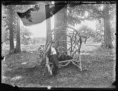 "view [Tanglewood]: father and a dog named ""Boy"" on rustic work settee. digital asset: [Tanglewood] [glass negative]: father and a dog named ""Boy"" on rustic work settee."