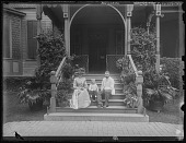view [Tanglewood]: the Hassons and Oscar Liebig on the stairs at Tanglewood. digital asset: [Tanglewood] [glass negative]: the Hassons and Oscar Liebig on the stairs at Tanglewood.