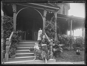 view [Tanglewood]: Cousin Florence, dog, Oscar Liebig, and Mrs. Liebig on front steps. digital asset: [Tanglewood] [glass negative]: Cousin Florence, dog, Oscar Liebig, and Mrs. Liebig on front steps.