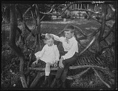 view [Tanglewood]: Walter and Oscar Liebig on a rustic settee. digital asset: [Tanglewood] [glass negative]: Walter and Oscar Liebig on a rustic settee.
