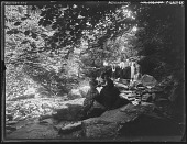view [Patapsco River Valley]: Cascade picnic. Two young women playing a game of cat's cradle. Three young boys in the background. digital asset: [Patapsco River Valley] [glass negative]: Cascade picnic. Two young women playing a game of cat's cradle. Three young boys in the background.