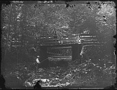 view [Miscellaneous Images in Maryland]: man at bridge and boy fishing in creek. digital asset: [Miscellaneous Images in Maryland] [glass negative]: man at bridge and boy fishing in creek.