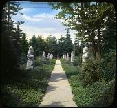 view [Abby Aldrich Rockefeller Garden]: walkway through stone sculptures. digital asset: [Abby Aldrich Rockefeller Garden]: walkway through stone sculptures.: [between 1914 and 1949?]