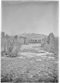 view [Miscellaneous Sites in New Hampshire, Series 1]: the Saco River, looking south toward a railroad bridge from what is now Route 302 in Glen, New Hampshire, in the town of Bartlett. digital asset: [Miscellaneous Sites in New Hampshire, Series 1] [glass negative]: the Saco River, looking south toward a railroad bridge from what is now Route 302 in Glen, New Hampshire, in the town of Bartlett.