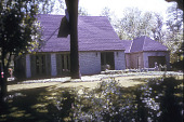 view [Krafft Garden]: lawn and ground cover plants in front of white brick house and garage. digital asset: [Krafft Garden]: lawn and ground cover plants in front of white brick house and garage.: 1968 Jun.