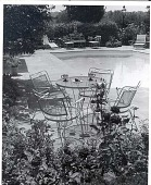 view [Eidnoc II]: swimming pool with seating area. digital asset: [Eidnoc II] [photoprint]: swimming pool with seating area.
