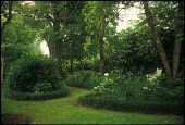 view [Joseph Thomas Mathis House Garden]: grassy paths between beds of hydrangea and perennials lined with liriope. digital asset: [Joseph Thomas Mathis House Garden]: grassy paths between beds of hydrangea and perennials lined with liriope.: 2007 May.