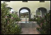 view Hotel Playa de Cortés: a courtyard and tile fountain, with an antique oil jar visible in the distance. digital asset: Hotel Playa de Cortés: a courtyard and tile fountain, with an antique oil jar visible in the distance.: 1937 Jan.