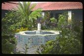 view Hotel Playa de Cortés: a plant-filled courtyard and tile fountain. digital asset: Hotel Playa de Cortés: a plant-filled courtyard and tile fountain.: 1937 Jan.