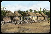 view Unidentified Site in The Barrancas, Mexico: thatch-roofed huts in a tropical setting. digital asset: Unidentified Site in The Barrancas, Mexico: thatch-roofed huts in a tropical setting.: 1937 Jan.