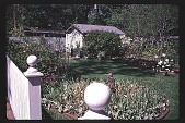 view [Untitled Garden]: from gate at drive across flower bed to shed. digital asset: [Untitled Garden]: from gate at drive across flower bed to shed.: 1997 Apr.