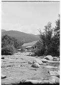 view [Miscellaneous Sites in New Hampshire, Series 1]: an unidentified location along a river in the White Mountains, with what appears to be an abandoned sawmill. digital asset: [Miscellaneous Sites in New Hampshire, Series 1] [glass negative]: an unidentified location along a river in the White Mountains, with what appears to be an abandoned sawmill.