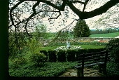 view [Dunwalke East]: stone wall surrounds circular garden with boy and swan sculpture in center. digital asset: [Dunwalke East]: stone wall surrounds circular garden with boy and swan sculpture in center.: 1984.