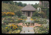 view [Vixen's Lair]: detail of front garden, with thyme mound in center and potting shed at end of walk; the design was subsequently changed for greater ease of maintenance. digital asset: [Vixen's Lair] [slide]: detail of front garden, with thyme mound in center and potting shed at end of walk; the design was subsequently changed for greater ease of maintenance.