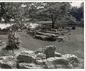view [Laurelwood Arboretum]: across sedimentary rocks and lawn to lake. digital asset: [Laurelwood Arboretum] [photoprint]: across sedimentary rocks and lawn to lake.