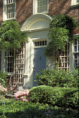 view [Prin Hall]: front door with trellises on each side of it. Boxwood border at walk. digital asset: [Prin Hall]: front door with trellises on each side of it. Boxwood border at walk.: 2002 May.