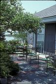 view [Beadleston Garden]: patio with water view beyond. digital asset: [Beadleston Garden] [slide]: patio with water view beyond.