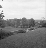 view [Frost Garden]: view over terrace to surrounding countryside. digital asset: [Frost Garden] [contact print and safety film negative]: view over terrace to surrounding countryside.