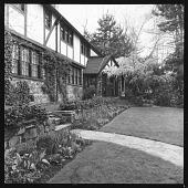 view [Auchincloss Garden]: house, garden border, and stone wall. digital asset: [Auchincloss Garden] [contact print]: house, garden border, and stone wall.