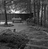 view [Gleason Garden]: looking down brick walkway to patio. digital asset: [Gleason Garden] [safety film negative]: looking down brick walkway to patio.