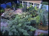 view [Mountsier/ Hardie Gardens]: Looking down on the garden, garage, painted walls, and covered hot tub. digital asset: [Mountsier/ Hardie Gardens] [transparency]: Looking down on the garden, garage, painted walls, and covered hot tub.