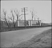 view [Miscellaneous Billboards and Signage]: billboards by the roadside advertising Prince Albert tobacco and Camel cigarettes. digital asset: [Miscellaneous Billboards and Signage]: billboards by the roadside advertising Prince Albert tobacco and Camel cigarettes.: [between 1914 and 1949?]