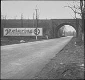 view [Miscellaneous Billboards and Signage]: billboard next to a bridge advertising Polarine motor oil. digital asset: [Miscellaneous Billboards and Signage]: billboard next to a bridge advertising Polarine motor oil.: [between 1914 and 1949?]