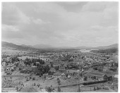 view [Miscellaneous Sites in the Adirondack Mountains]: bird's-eye view of part of the village of Saranac Lake, with the Adirondack Greenhouses at the corner of Broadway and Ampersand Avenue in the right center foreground and Lower Saranac Lake in the backg... digital asset: [Miscellaneous Sites in the Adirondack Mountains] [glass negative]: bird's-eye view of part of the village of Saranac Lake, with the Adirondack Greenhouses at the corner of Broadway and Ampersand Avenue i[...]