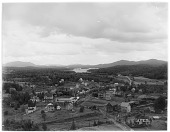 view [Miscellaneous Sites in the Adirondack Mountains]: bird's-eye view of part of the village of Saranac Lake, with the Adirondack Greenhouses at the corner of Broadway and Ampersand Avenue in the left center foreground and Lower Saranac Lake in the backgr... digital asset: [Miscellaneous Sites in the Adirondack Mountains] [glass negative]: bird's-eye view of part of the village of Saranac Lake, with the Adirondack Greenhouses at the corner of Broadway and Ampersand Avenue [...]