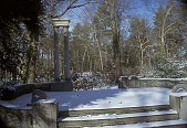 """view [Avondale Farm]: the """"sitting place"""" with limestone columns overlooking perennial garden in winter. digital asset: [Avondale Farm]: the """"sitting place"""" with limestone columns overlooking perennial garden in winter.: 2002 Jan."""