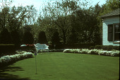 view [The Garden of Mr. and Mrs. Russell Farley]: putting green and white settee; white flower border and hedges. digital asset: [The Garden of Mr. and Mrs. Russell Farley]: putting green and white settee; white flower border and hedges.: 1965.