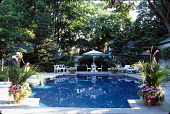 view [French Norman Manor House]: swimming pool seating and pots. digital asset: [French Norman Manor House]: swimming pool seating and pots.: 2007 Jun.